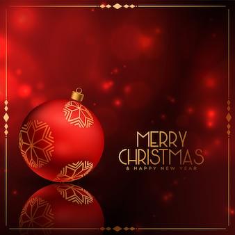Carte de voeux joyeux noël rouge brillant avec décoration de boule