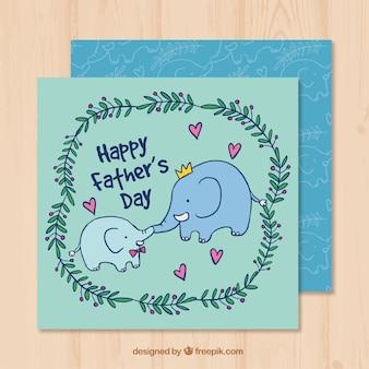 Carte de voeux à la main avec des éléphants pour le jour du père