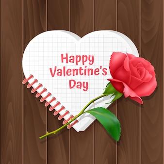 Carte de voeux de la saint-valentin, une carte avec un cahier en forme de coeur et une rose réaliste