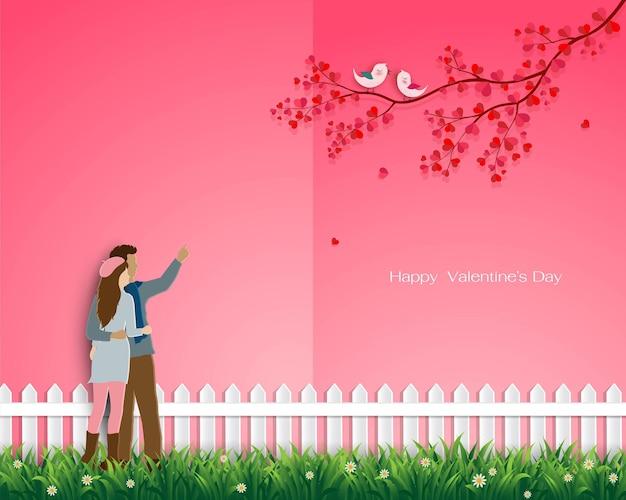 Carte de voeux saint valentin avec couple heureux sur le jardin de l'amour