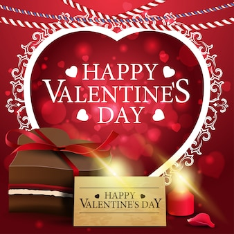 Carte de voeux saint valentin rouge avec des bonbons au chocolat
