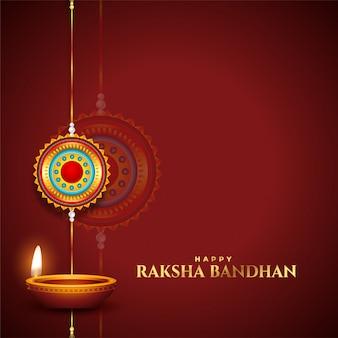 Carte de voeux traditionnelle raksha bandhan avec diya et rakhi
