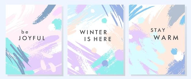 Cartes d'hiver artistiques uniques avec des formes et des textures dessinées à la main dans des couleurs pastel douces. design graphique tendance parfait pour les impressions, les dépliants, les bannières, les invitations, les offres spéciales et plus encore. collages vectoriels.