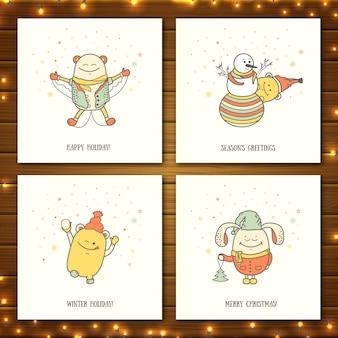 Cartes de voeux de noël avec des monstres mignons. personnages de dessins animés jouent et divertissent l'hiver
