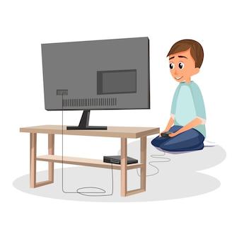 Cartoon boy play videogame controller asseyez-vous sur le sol