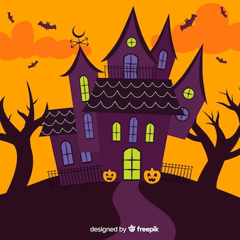 Cartoon maison d'halloween au design plat