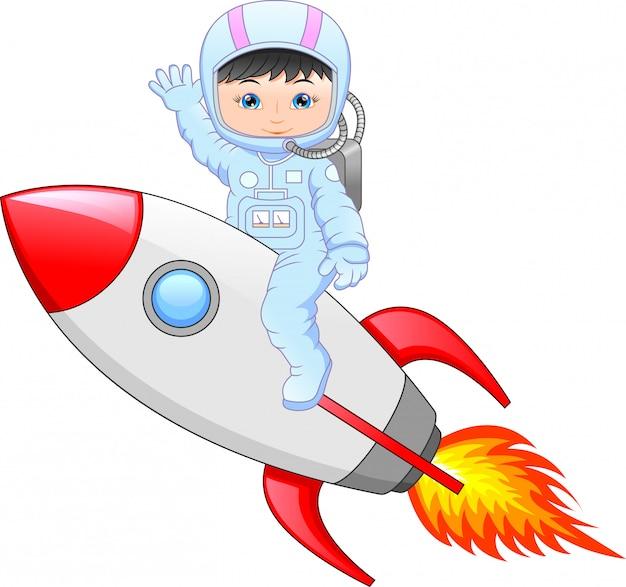 Cartoon petite fille portant un costume d'astronaute sur une fusée