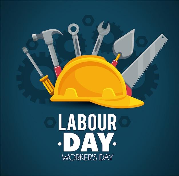 Casque avec des outils de construction à la fête du travail