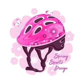 Casque rose avec un motif floral pour le roller.