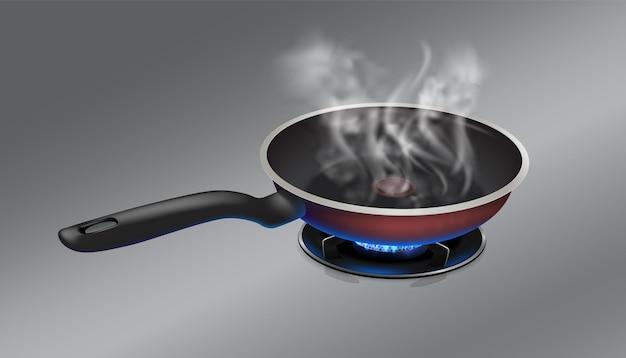 La casserole chaude brûle sur un fond en métal d'acier inoxydable de cuisinière à gaz