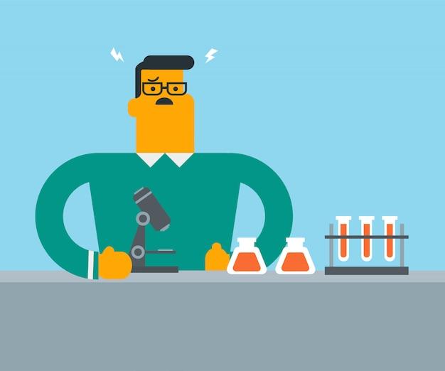 Caucasien étudiant travaillant en classe de laboratoire.