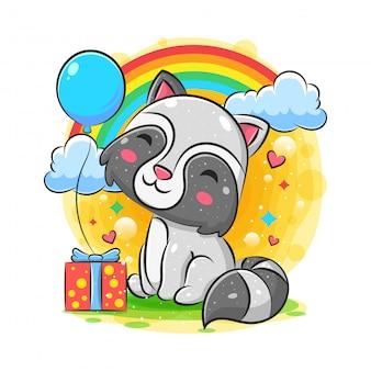 Célébration de raton laveur joyeux anniversaire avec fond de cadeau et ballon
