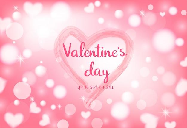 Célébration de la saint-valentin sur fond de bokeh coeur léger.