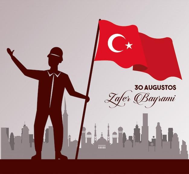 Célébration de zafer bayrami avec soldat et drapeau sur la ville