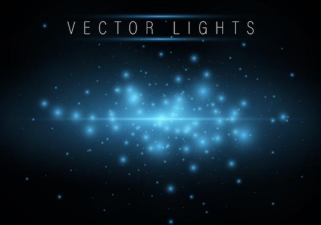Cercles de lumière magique bleu brillant et particules défocalisées