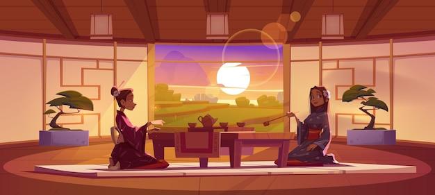 Cérémonie du thé dans la salle du dojo les femmes en kimono traditionnel s'assoient à table basse servi