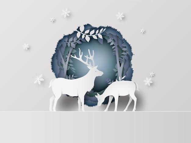 Cerf en forêt avec de la neige. style d'art de papier.