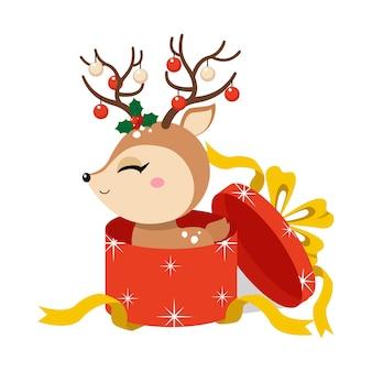 Cerf mignon dans une boîte de cadeau de noël