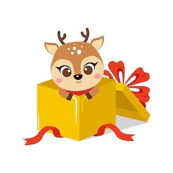 Cerf mignon dans une boîte cadeau de noël