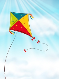 Cerf-volant coloré volant dans le ciel bleu