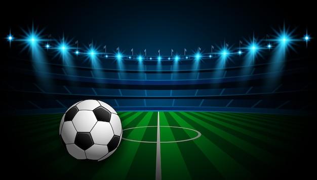 Champ de l'arène de football avec des lumières de lueur du stade lumineux
