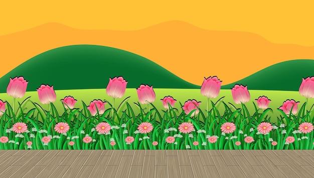 Champ de fleurs et herbe verte avec toile de fond de montagne au coucher du soleil