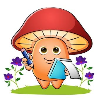 Le champignon tient un mini livre et un crayon d'illustration