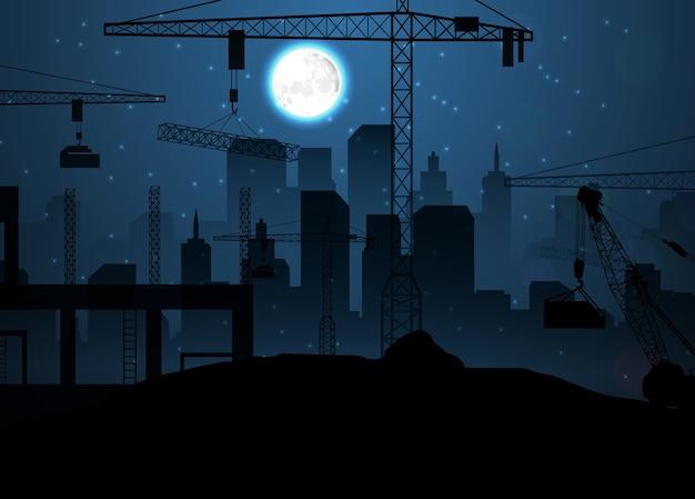 Chantier de construction avec des grues sur le ciel nocturne et la lune