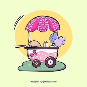 Chariot de coton et de bonbons sur l'herbe