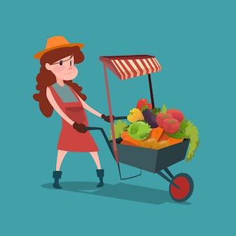 Chariot femme avec un magasin de légumes frais