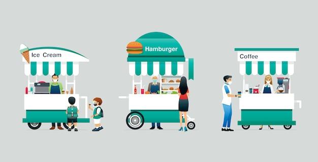 Les chariots de nourriture et les clients portent des masques pour éviter les germes.