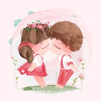 Un charmant couple s'embrassant le jour de la saint-valentin au milieu de la nature vibrante.
