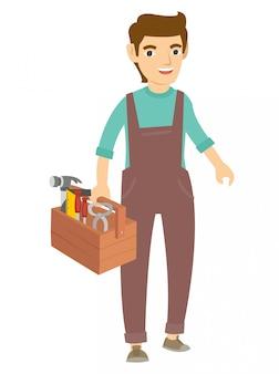 Un charpentier marche et tient beaucoup d'outils pour le travail