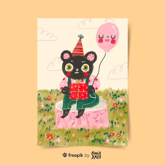 Chat assis sur un champ avec une carte de voeux d'anniversaire ballon