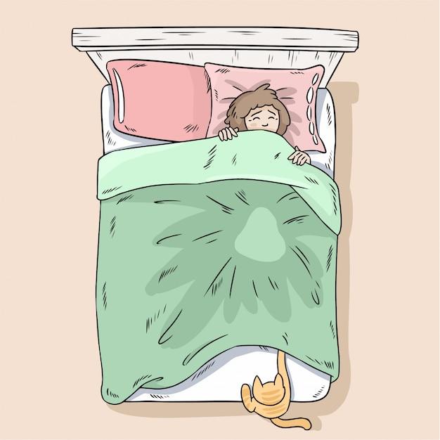 Chat attrapant des pattes sous la couverture