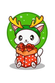 Un chat blanc portant un cadeau de noël portant un bandeau en corne de renne