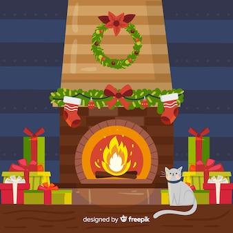 Chat à la cheminée fond de noël