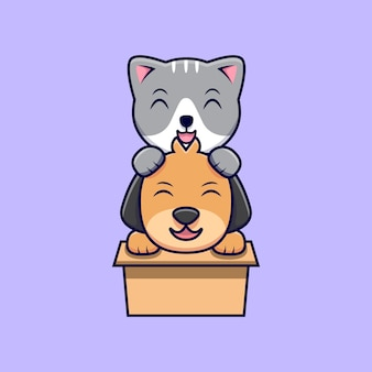 Chat et chien mignon jouant dans une boîte en carton