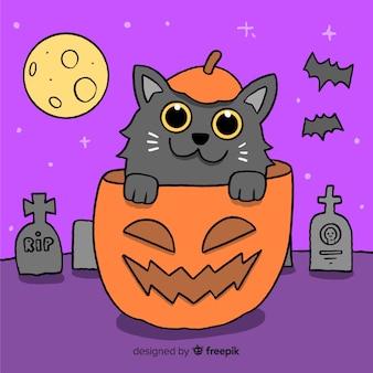 Chat dessiné à la main dans une citrouille d'halloween