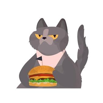 Chat drôle avec un regard sérieux tient un hamburger. le chat tient un hamburger.