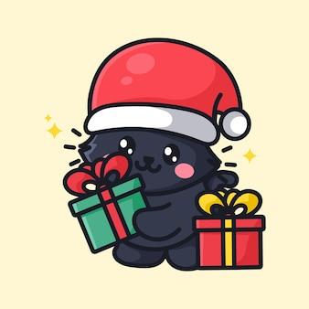 Le chat mignon célèbre le nouvel an de noël