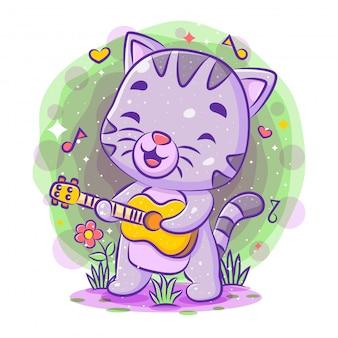 Chat mignon chantant et jouant de la guitare