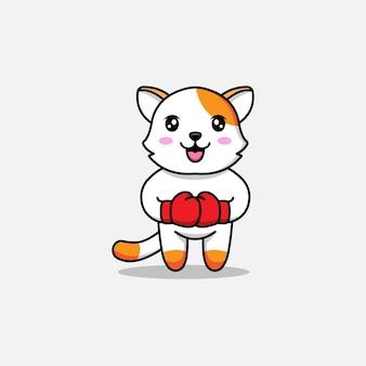 Chat mignon avec des gants de boxe