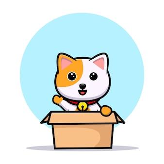 Chat mignon à l'intérieur de la boîte et agitant la mascotte de dessin animé à la main