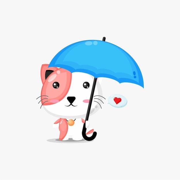 Chat mignon portant un parapluie
