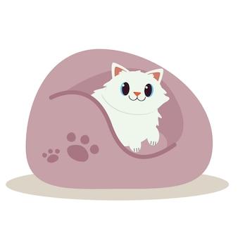 Un chat mignon qui dort sur le pouf et qui a l'air heureux