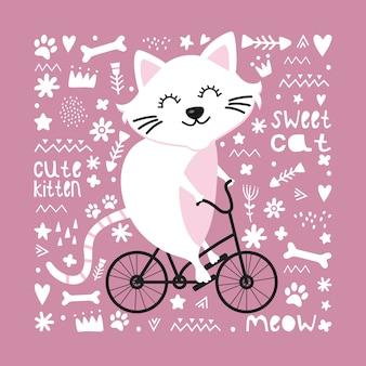 Chat mignon sur un vélo.