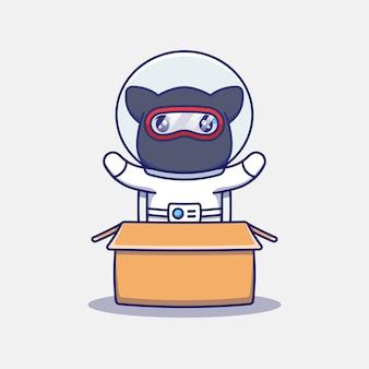 Chat ninja mignon portant un costume d'astronaute dans le carton