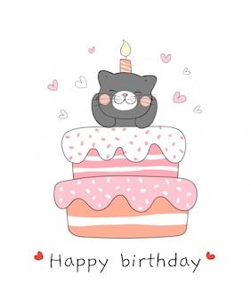 Chat noir avec un gâteau sucré pour l'anniversaire.