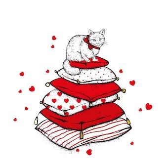 Chat et oreillers isolés sur blanc